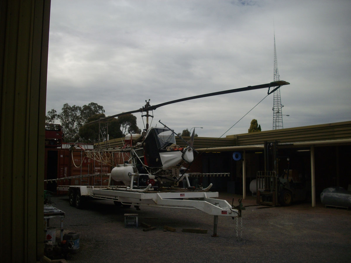The crop dusting helicopter has a custom built trailer built by the Spray shop