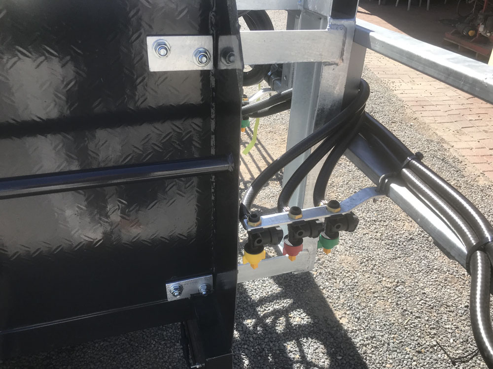 Coloured Hose connectors mounted on the corners of the trailer