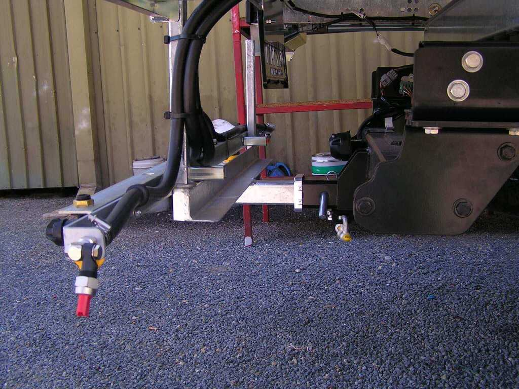 Firebreak boom fitted to towbar
