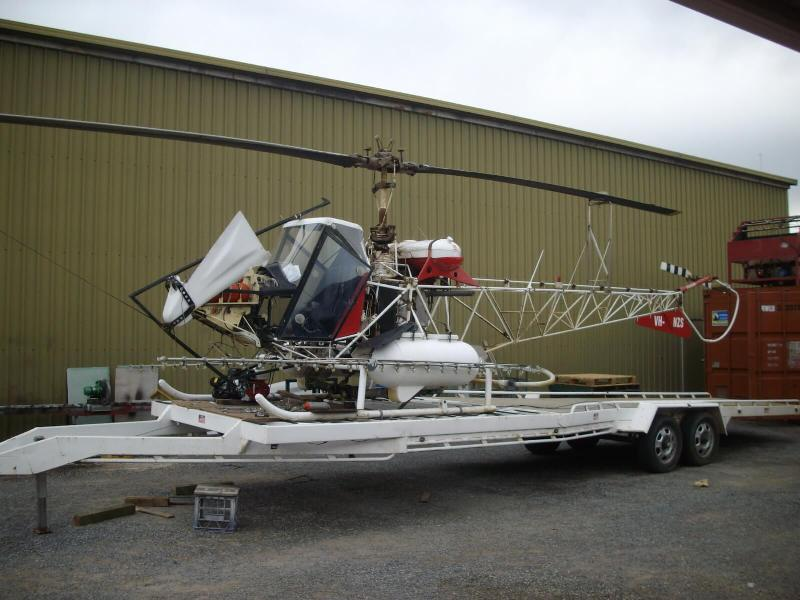 Chemical application kit added to helicopter for spraying of vegetables.